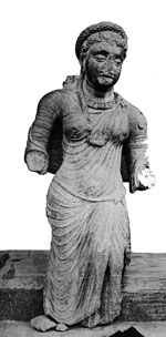 Ancient Indian clothing: A woman wearing a long tunic - Mathura, 100s AD