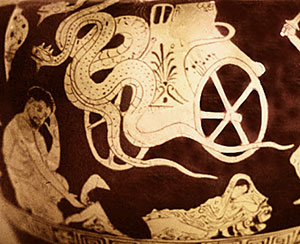red figure vase of a chariot drawn by dragons, a man, dead children