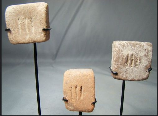 Square clay tokens from Mehrgarh