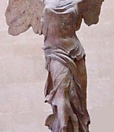Winged victory: stone statue of woman with wings