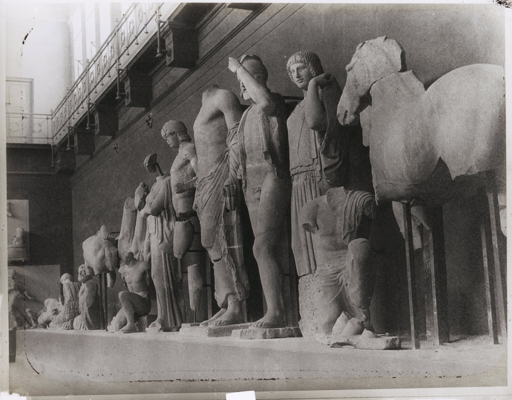 Pelops: a group of stone statues seen from the side