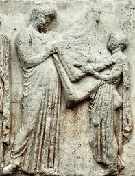 The center of the Parthenon frieze: a woman and a girl fold a cloth
