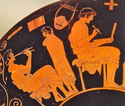 A teacher shows a boy how to play pipes; a lyre hangs on the wall
