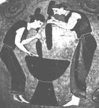 Women pounding wheat or barley into flour
