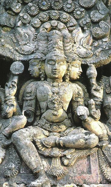 Prajapati: a stone statue of a god with faces looking in every direction