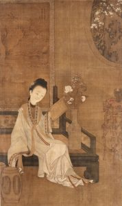 Qing dynasty court lady reading a handwritten scroll (probably 1700s AD)