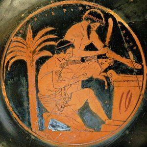 Two men sacrifice a pig on an altar, preparing to eat the pork. Greek red figure vase.