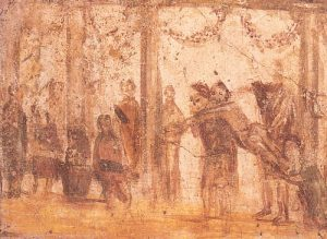 painting of a room with columns. A group of boys stand and watch. One boy is stripped naked and piggybacked on another boy's back, while a larger man raises a stick.