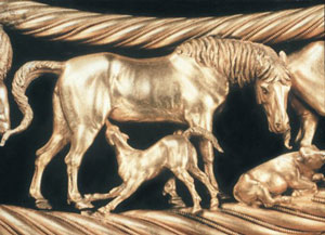 Closeup of a tiny gold horse and her colt nursing, from Scythian jewelry - Herodotus visited the Scythians