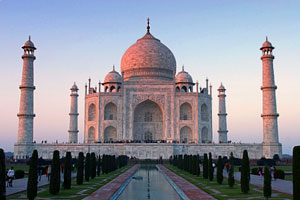 Taj Mahal: a big white building with thin towers and a dome