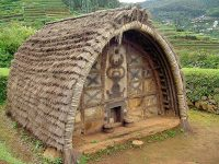 A barrel-vaulted thatched house in rural India today.