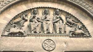 carving of three men sitting together