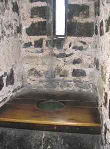A latrine in the White Tower with a wooden seat