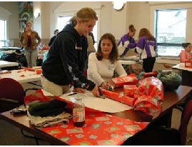 Wrapping presents at a table