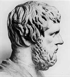 Xenophon: a stone bust of a white man with longish shaggy hair and a full beard