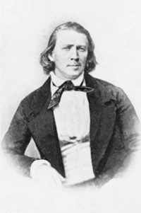 Brigham Young: a young white man in a white shirt and dark jacket
