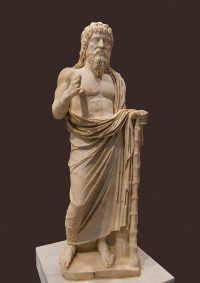 Roman holy man with long hair, bare feet, and a robe