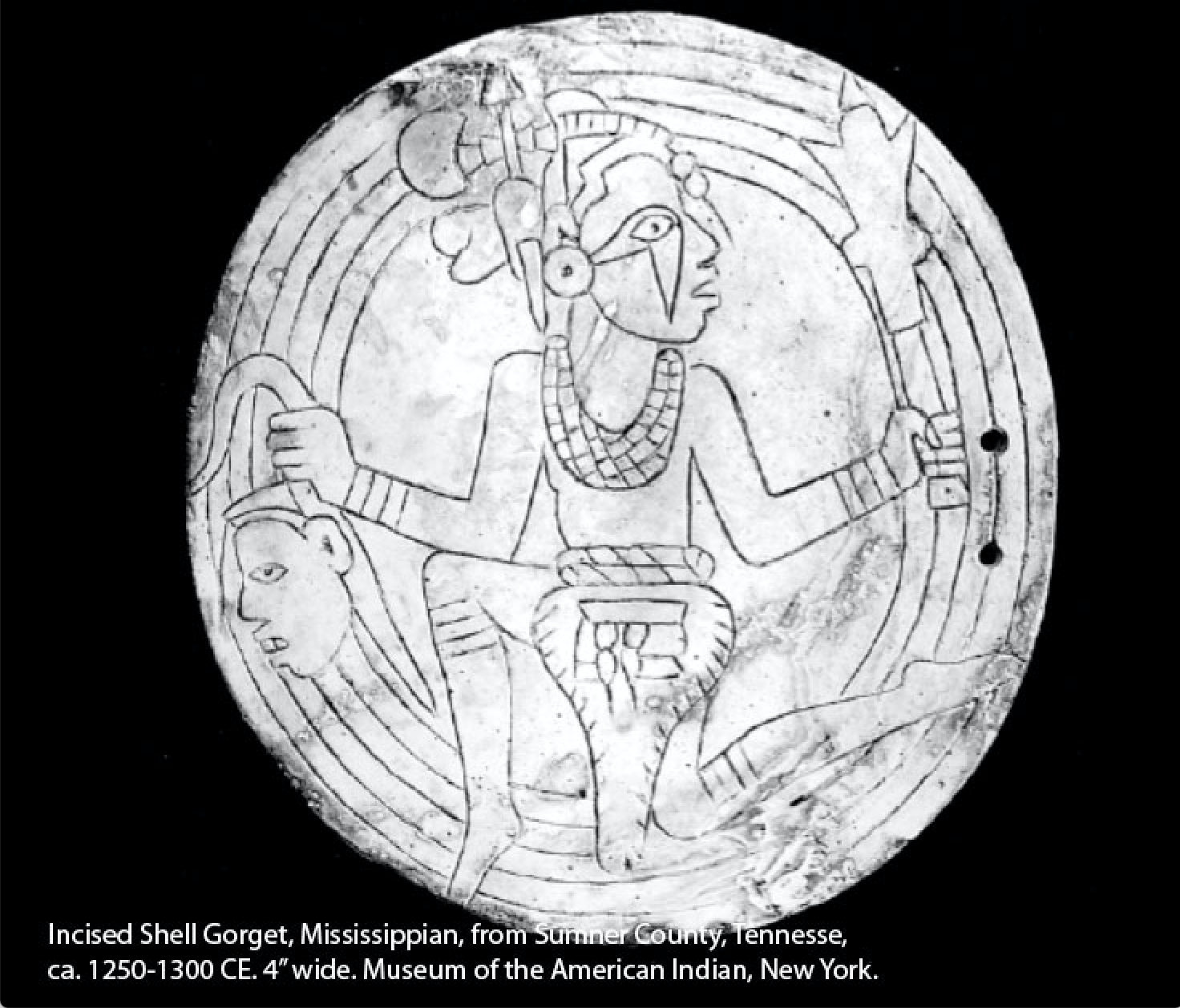 a white circle with a man carved into it and circles.