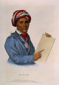 Drawing of a Native man wearing a turban and pointing to a written Cherokee alphabet: American literature