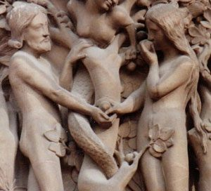 Adam and Eve eating the apple. The woman in the tree is the snake (Notre Dame Cathedral, 1200s AD)
