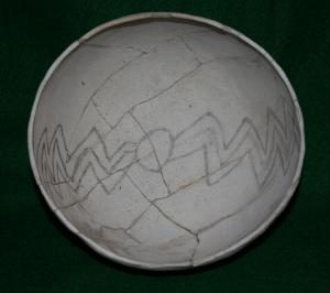 A bowl with a painted design on the inside