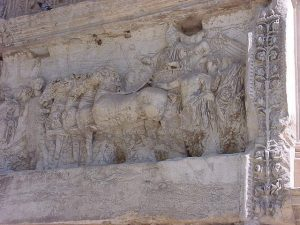 Arch of Titus: The Roman emperor Titus rides in a chariot drawn by horses.