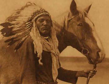 Blackfoot man with horse