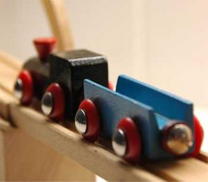 Brio trains have magnets at the ends.