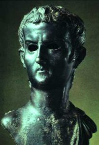 Caligula: a bronze head of a white man with short hair and no beard