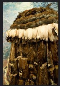 Cherokee feather cloak made of brown and white feathers: Native American clothing history