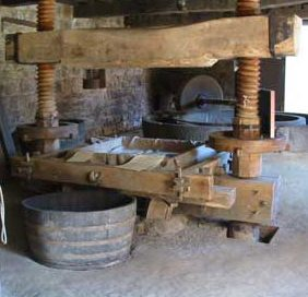 A cider press with a big wooden screw