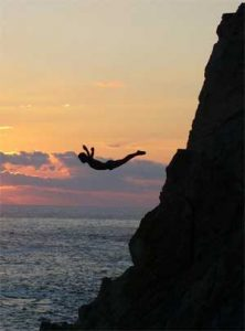 A person diving from a cliff
