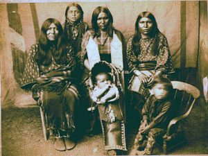 Comanche women with a baby