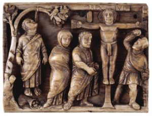 An early crucifixion: Jesus is on the cross, but Judas has hanged himself in shame. About 420 AD (The Maskell Ivories, British Museum)