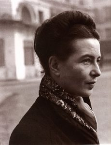 Simone de Beauvoir: a white woman with dark hair and a scarf