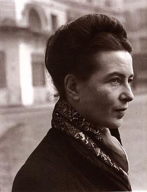 Simone de Beauvoir: a white woman with dark hair and a scarf