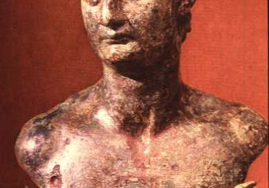 Domitian: a beardless white man with short curly hair