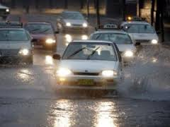 People driving cars to work in the rain