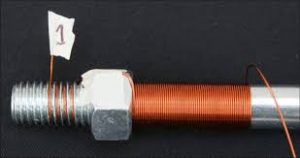 An electromagnet: lots of copper wire wound around an iron core.