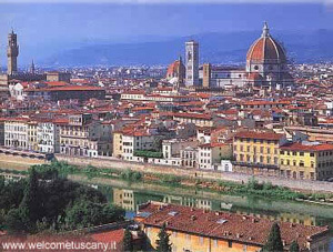 A small city of red tile roofs with the big dome of the Cathedral rising above them - the city of Dante Alighieri