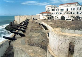 Slave fort: white buildings along a beach