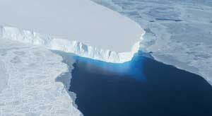 A glacier: ice and blue water