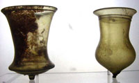 These are medieval glass cups - they actually do stand up enough to keep from spilling, despite the bumps on the bottom