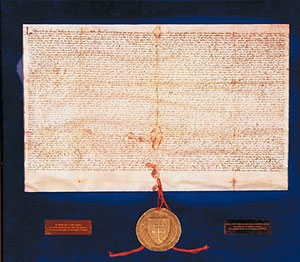 A parchment with writing on it and a big golden seal with red trim - Medieval Hungary, the Golden Bull