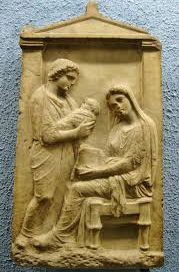 A Greek tombstone showing a seated woman and a man holding a baby