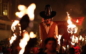 Carrying a puppet of Guy Fawkes to burn him