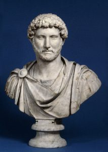 The Roman emperor Hadrian: a white man with curly hair and a trimmed beard