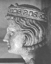 Stone carving of a young white man with a crown