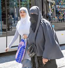 Women wearing Islamic veils and abayahs