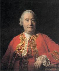 David Hume, the European philosopher: a middle-aged white man in a fancy red top.